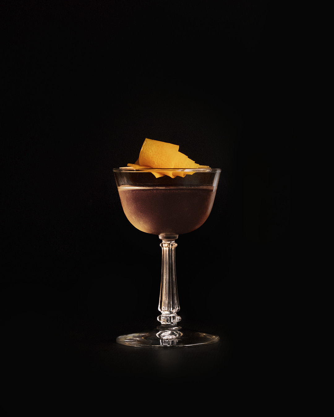 CLASSIC GIN MARTINI   1  oz  Gin 1  oz  Pomp & Whimsy 1  oz  french vermouth dash angostura bitters   Combine ingredients in a mixing glass or cocktail shaker and fill with ice. Stir well to chill.    Strain into a chilled cocktail glass.    Twist a piece of lemon peel over the drink for aromatics and use the twist as a garnish.