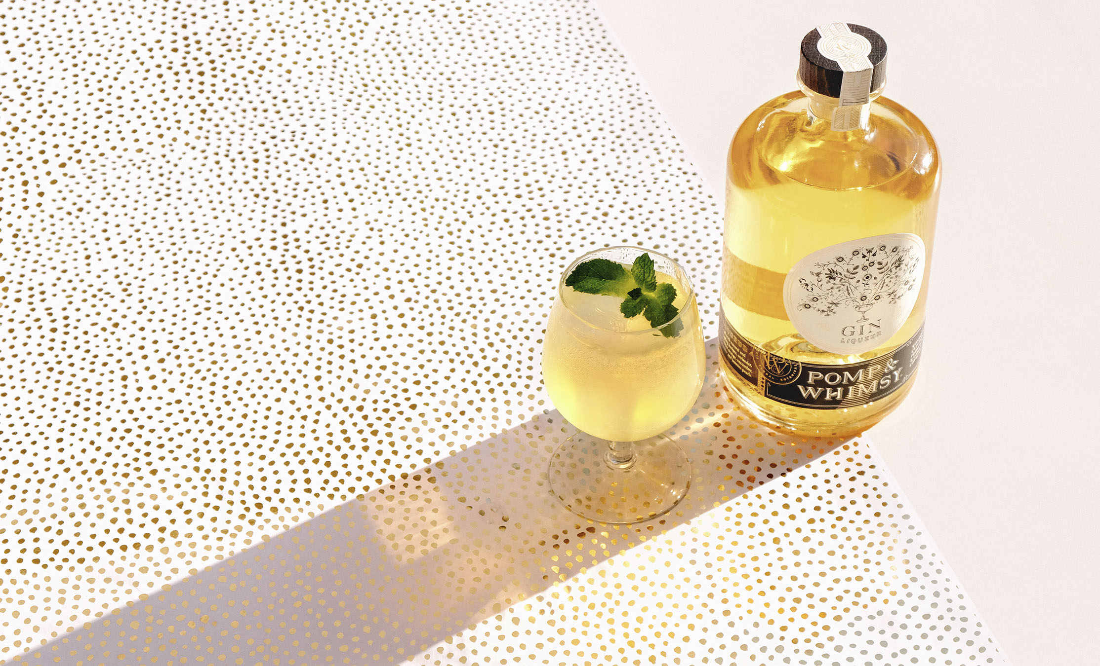A FINE FILLY   1½  oz  Pomp & Whimsy ¾  oz  ginger syrup ½  oz  lime club soda   Add all ingredients to shaker and shake for 10 seconds. Strain into glass and add club soda.    Garnish with a handful of mint.