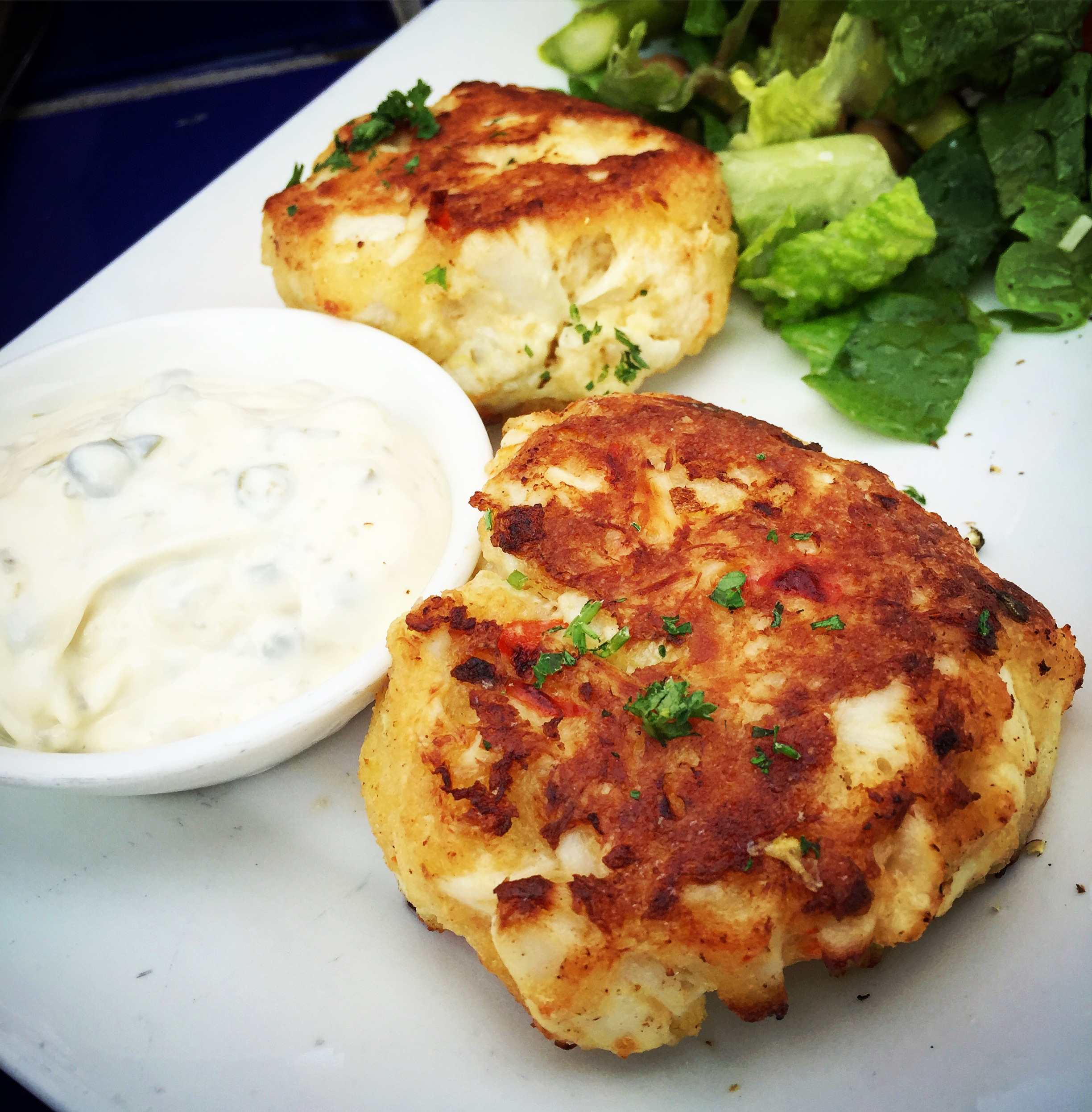 The Calypso Crabcakes with a caper sauce are the fluffiest and most loaded ones I've ever had (just look at how large that crab meat is!)
