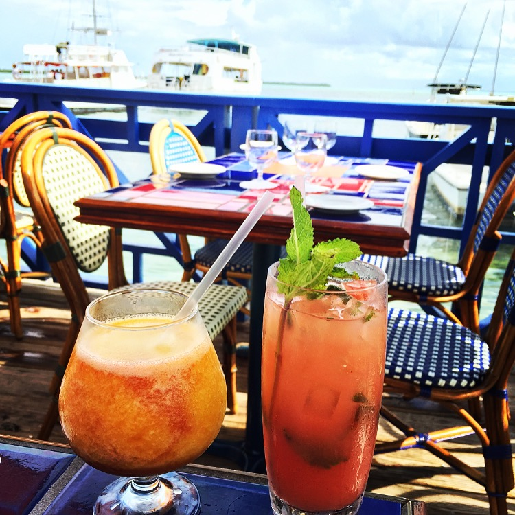 Cocktails overlooking the North Sound.  Try the Calpyso Cocktail or the freshly squeezed Watermelon Mojito