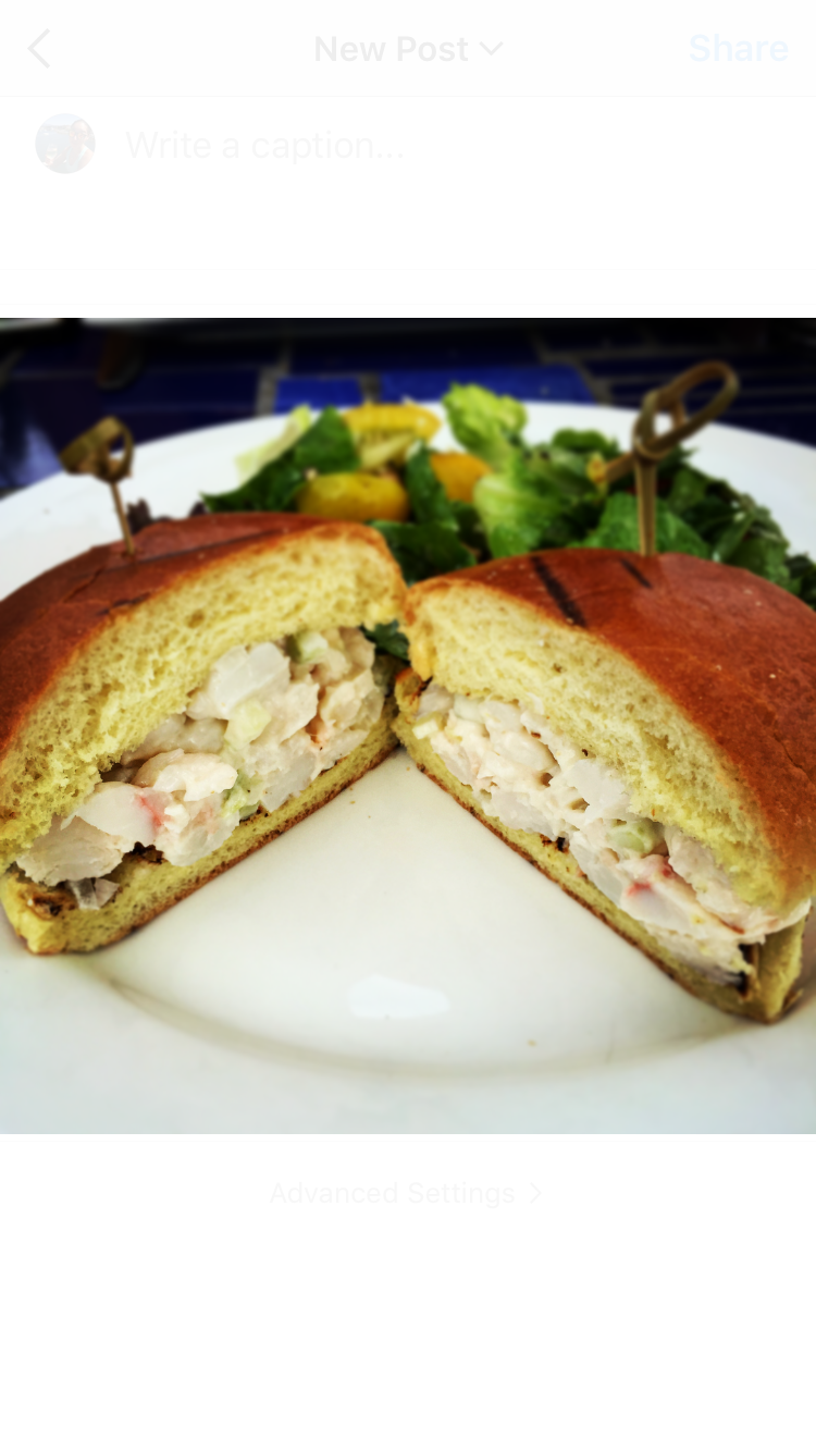 Lobster Roll: Lightly dressed, fresh Cayman lobster in a buttery bun