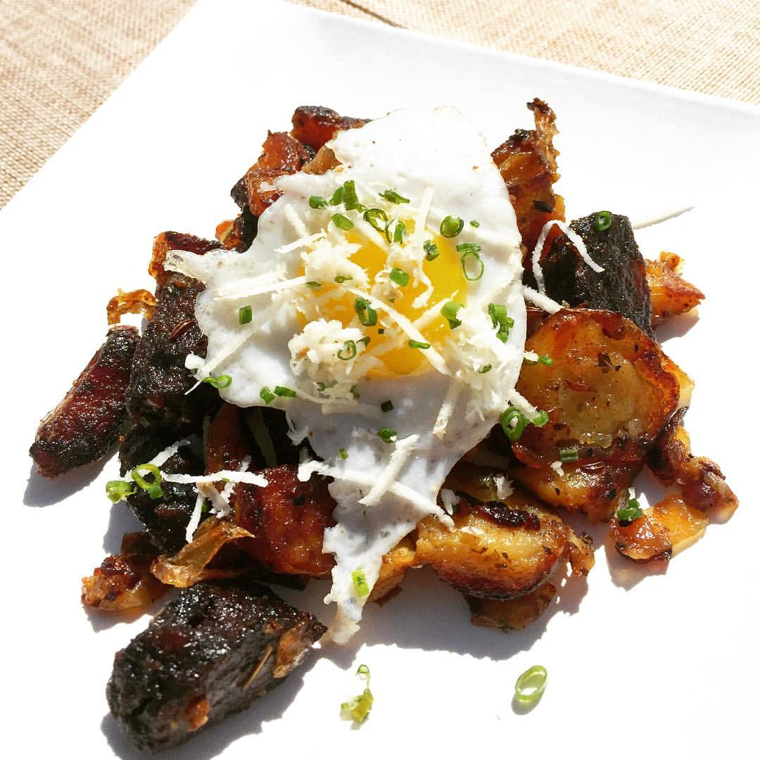Luca's Austrian blood sausage & potatoes topped with a quail egg