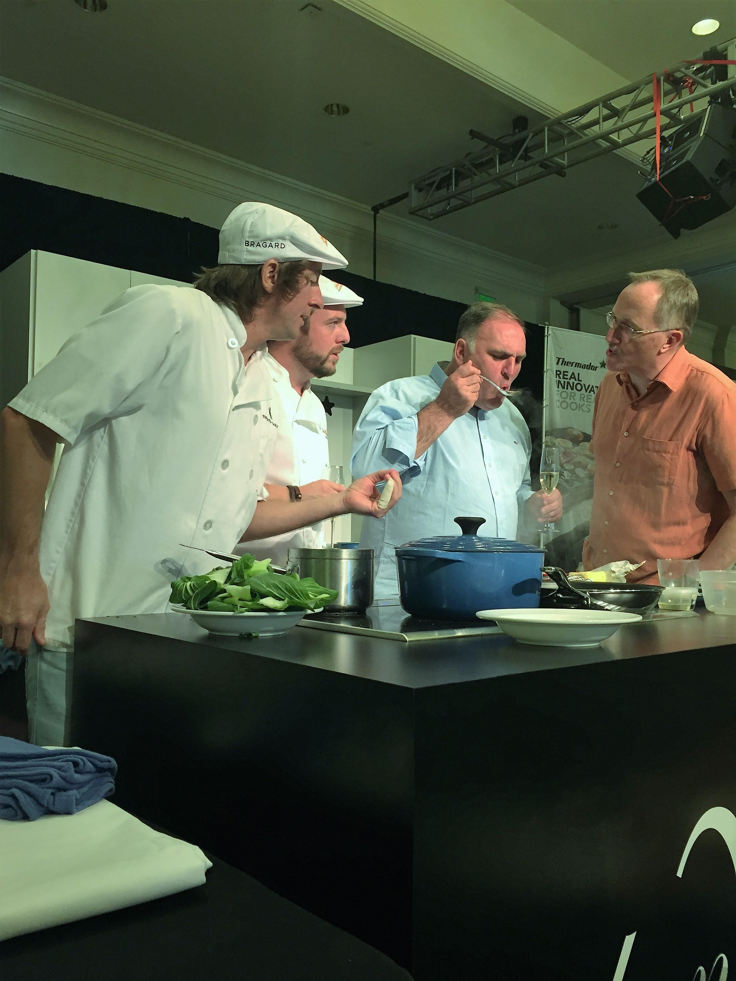 Chef José Andrés tasting amateur chef Neville Hicks' dish