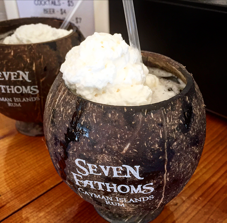A coconut cocktail in Seven Fathom's signature coconut cup