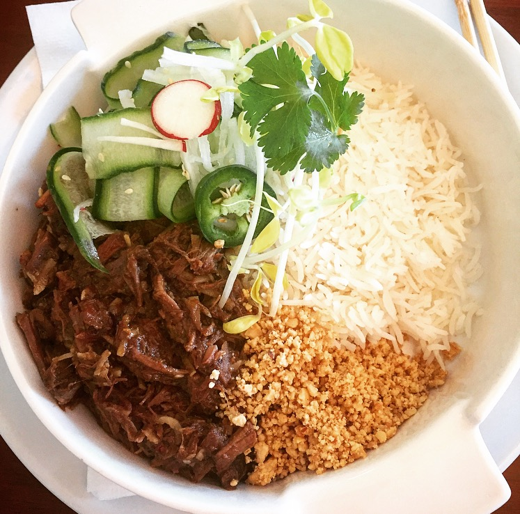 Now this is one hell of a main course: Lamb Rendang. An Indonesian curry with rice, peanuts and cucumber salad.
