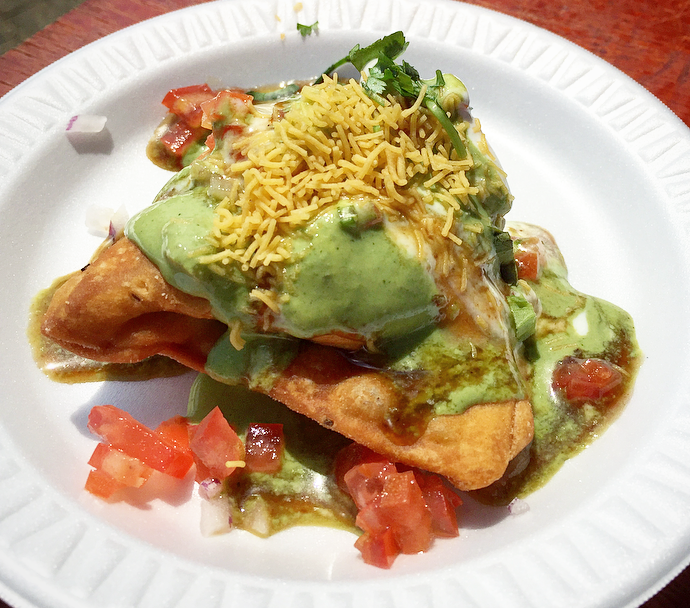 Upcoming Camana Bay restaurant Pani Indian Kitchen served up a flavourful vegetable samosa chat with a mint and tamarind chutney.