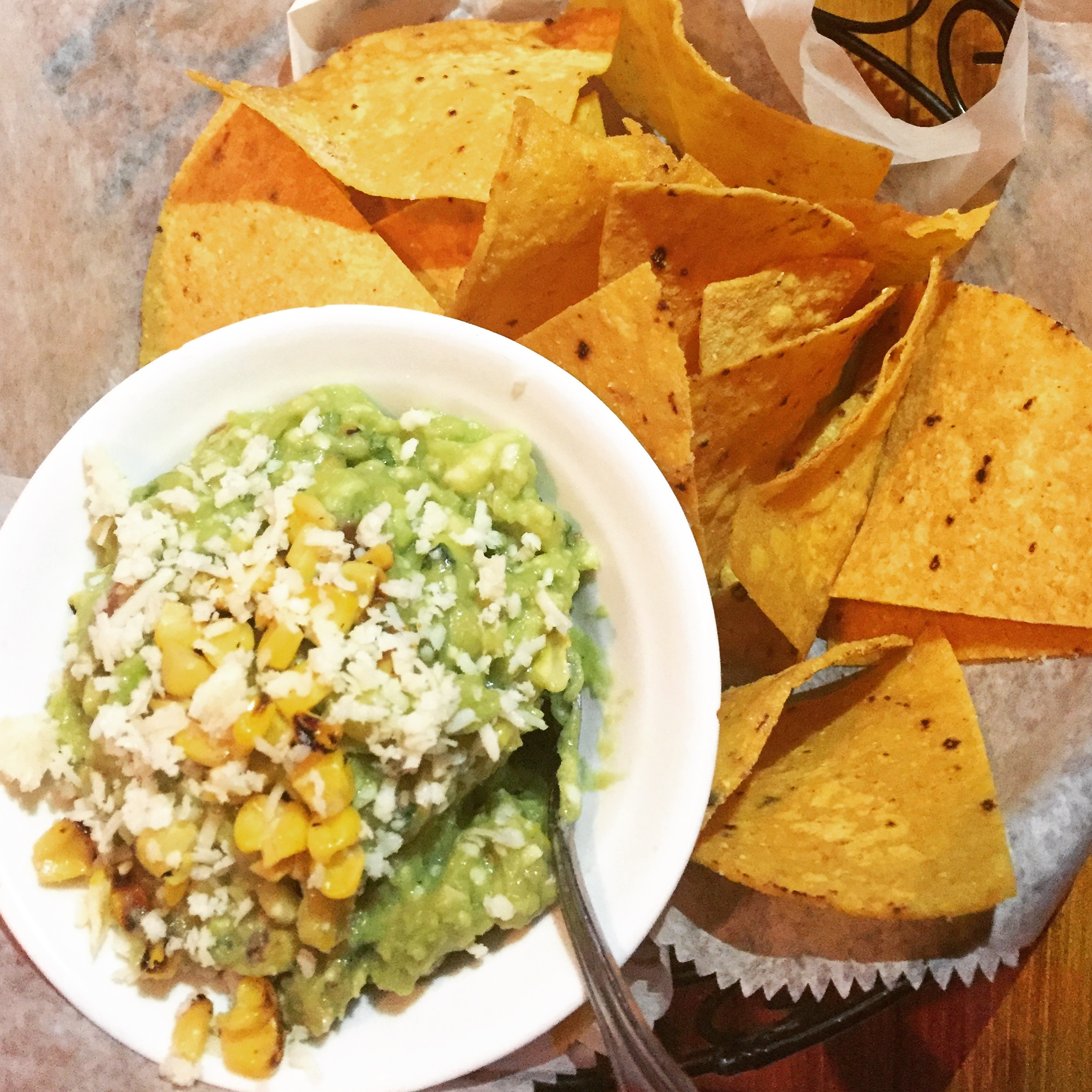 Roasted corn, onion, jalapeno, Cotija cheese and lime guacamole with homemade corn tortilla chips
