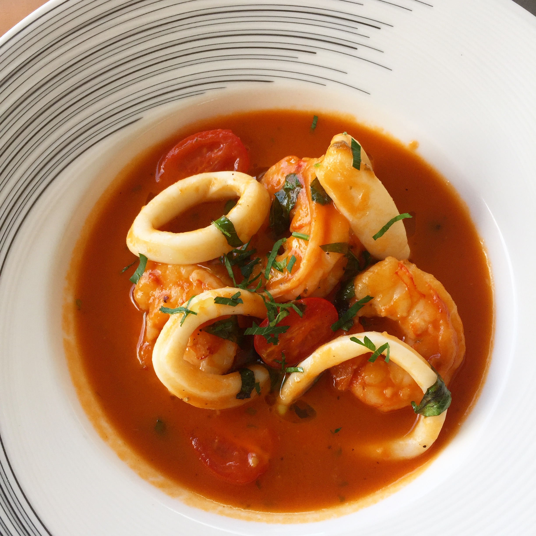 Shrimp & Calamari Guazetto in a garlic, basil, white wine and tomato broth.