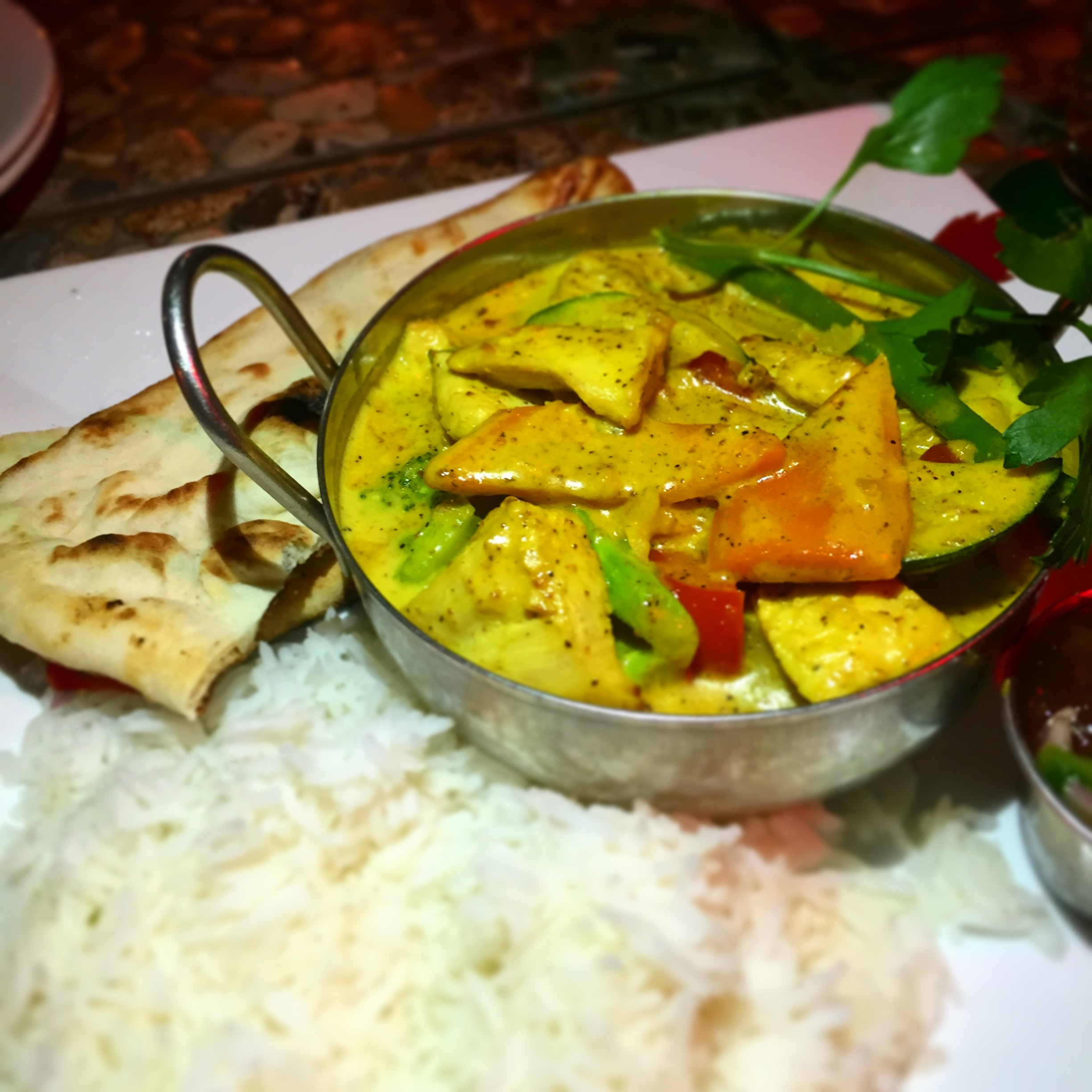 West Indian Chicken Curry served with white rice, naan bread and mango chutney