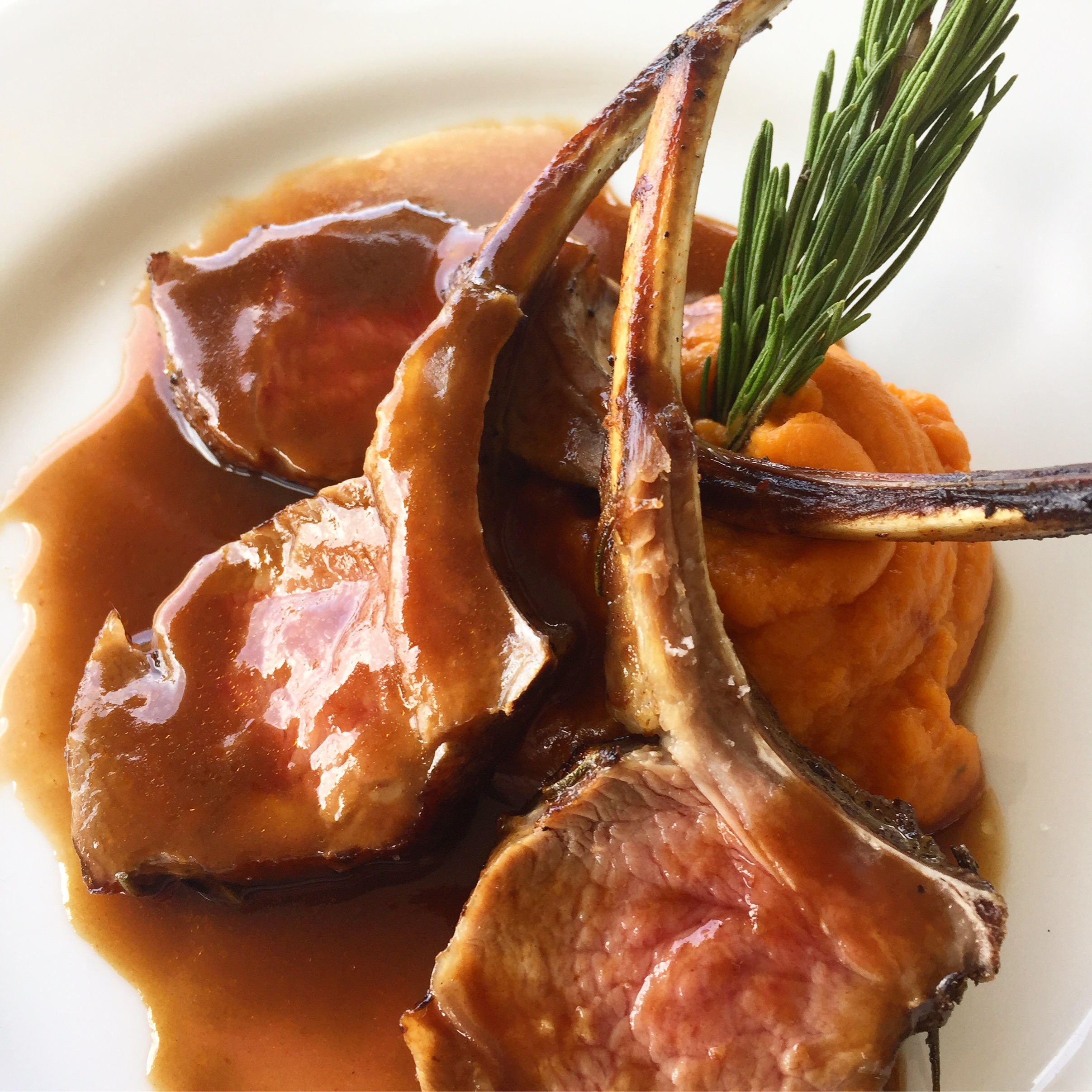 Succulent Rosemary Lamb Chops served with a creamy sweet potato mash and mint demi glacé