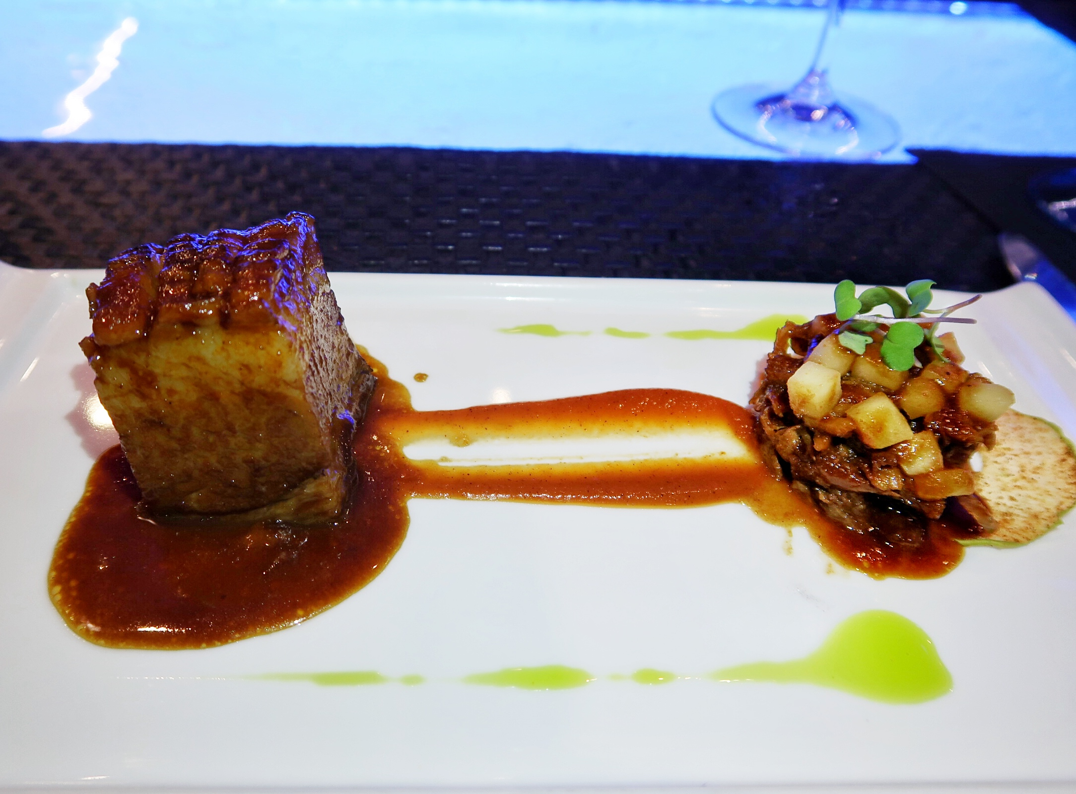 Pork Two Ways:  Braised pork belly in a guava marinade and pulled baby back ribs in a vindaloo sauce and apple chutney