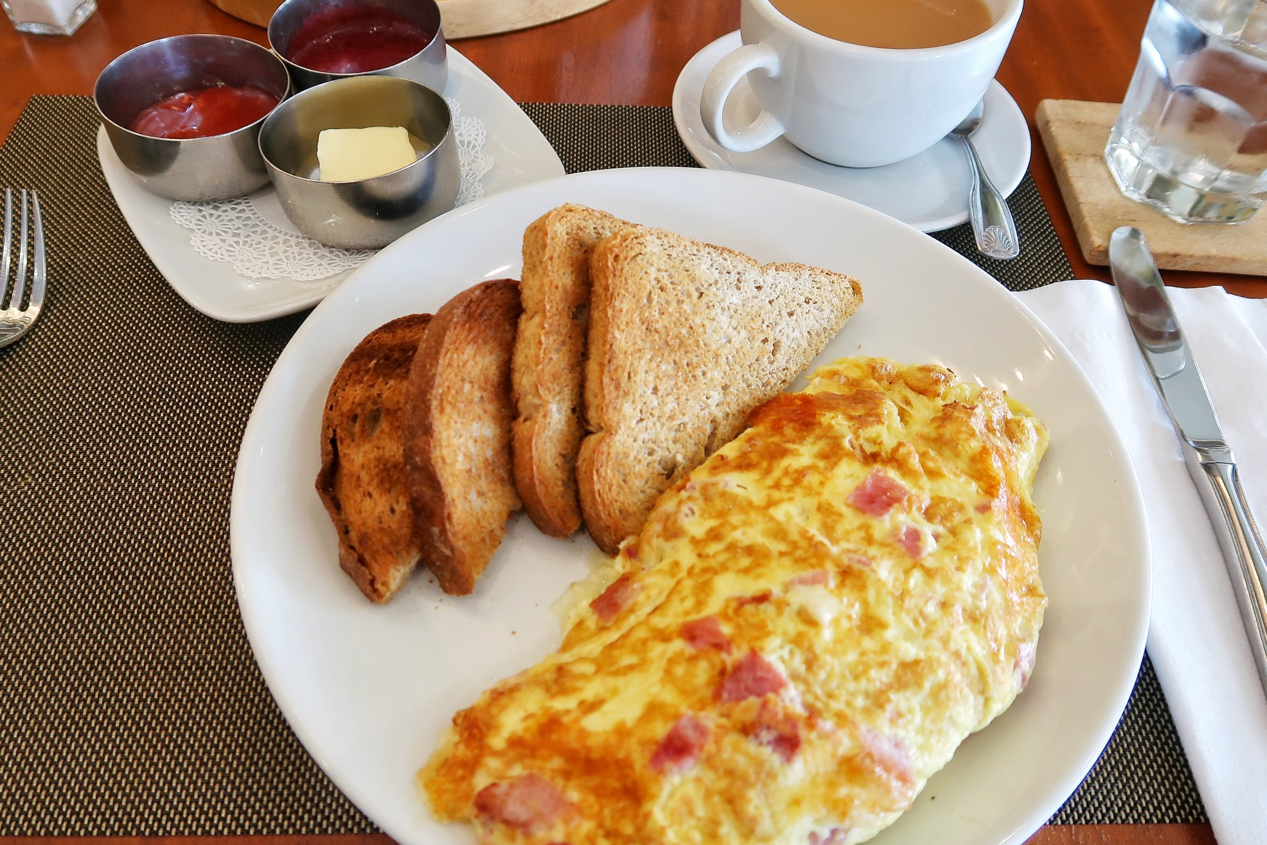 A fluffy and luscious Ham & Cheese Omelette with toast