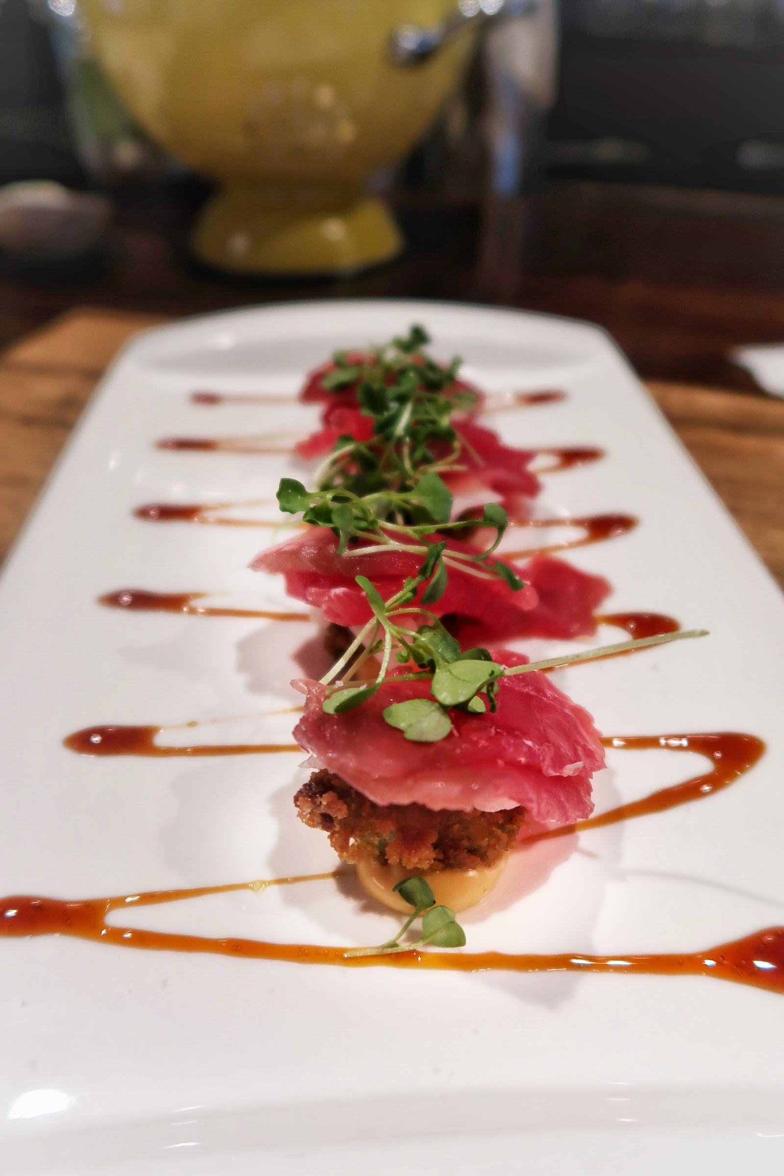 Stunning and tasty Tuna Sashimi; fresh local tuna, pickled jicama, fried avocado, unagi sauce and a dollop of spiced aioli.