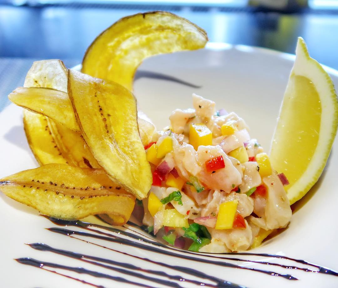 Tropical Ceviche - local wahoo, mango, red onion, peppers and lemon served with a balsamic reduction and plantain chips.