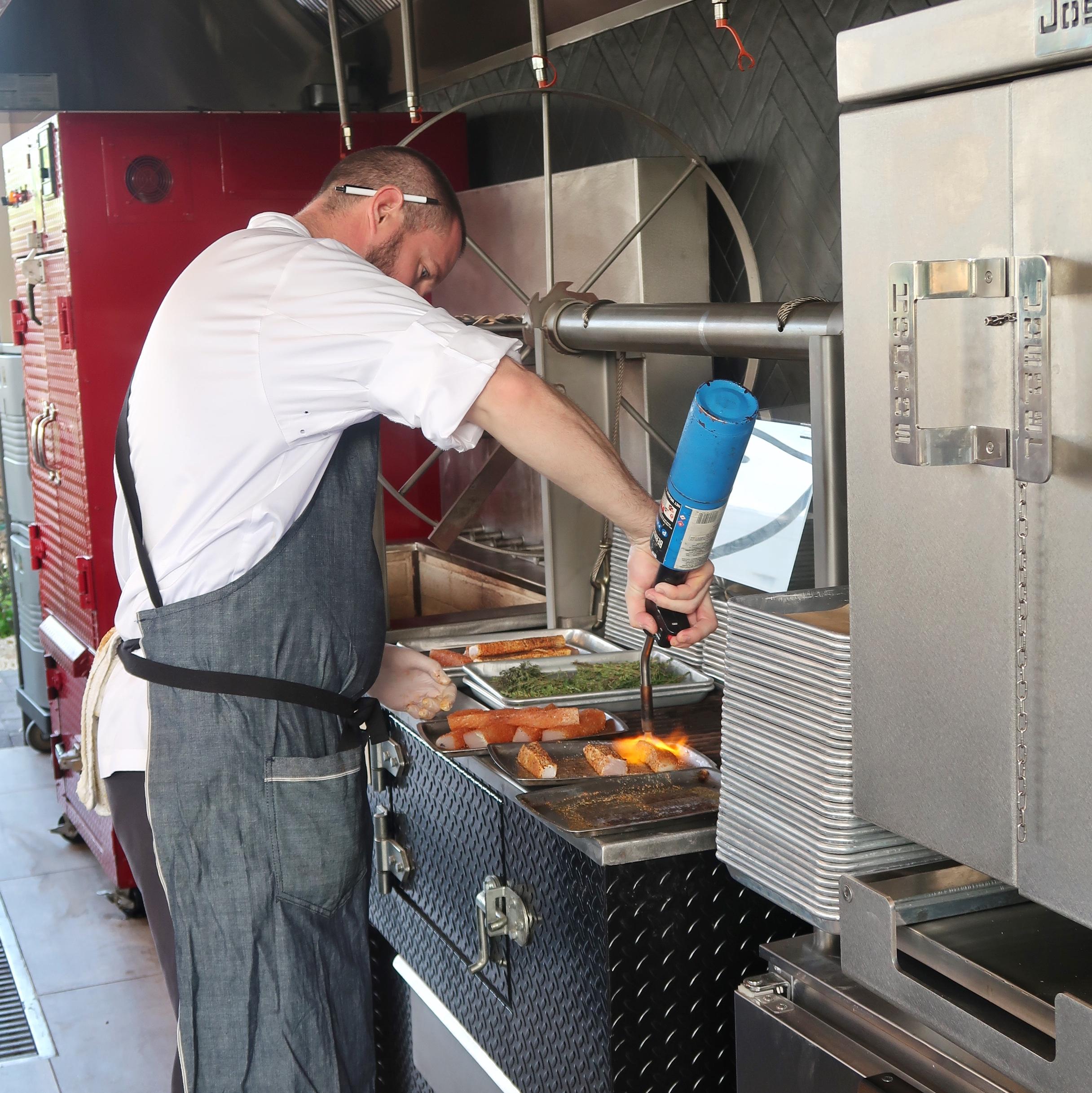 Chef Thomas Tennant torching his wahoo