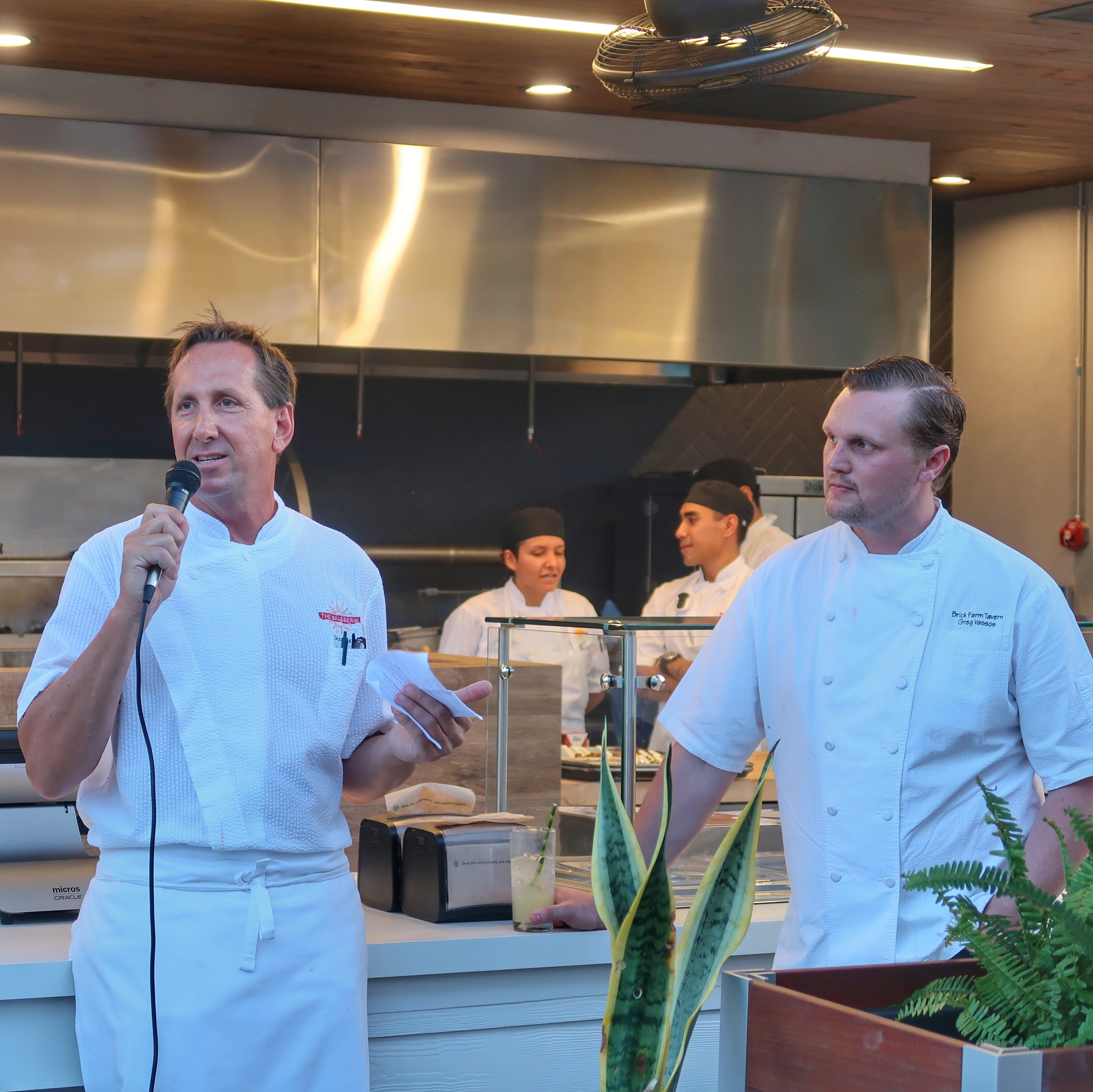 The Brasserie's Consultant Chef Dean Max welcomes guests as Chef Greg Vassos looks on