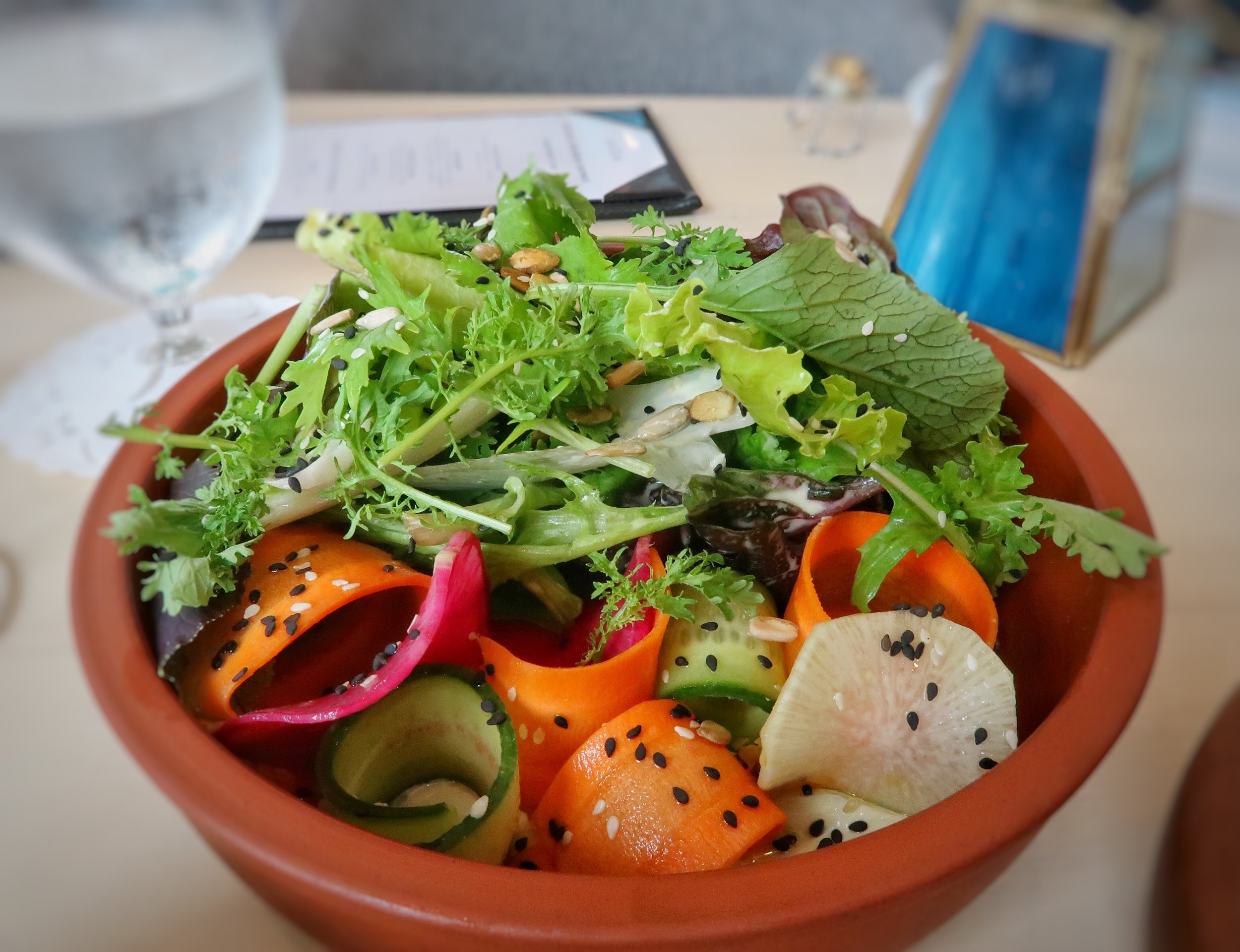 The Misticanza Salad with local crisp greens, crunchy vegetables, seeds, sesame and a delicious cucumber tahini dressing.