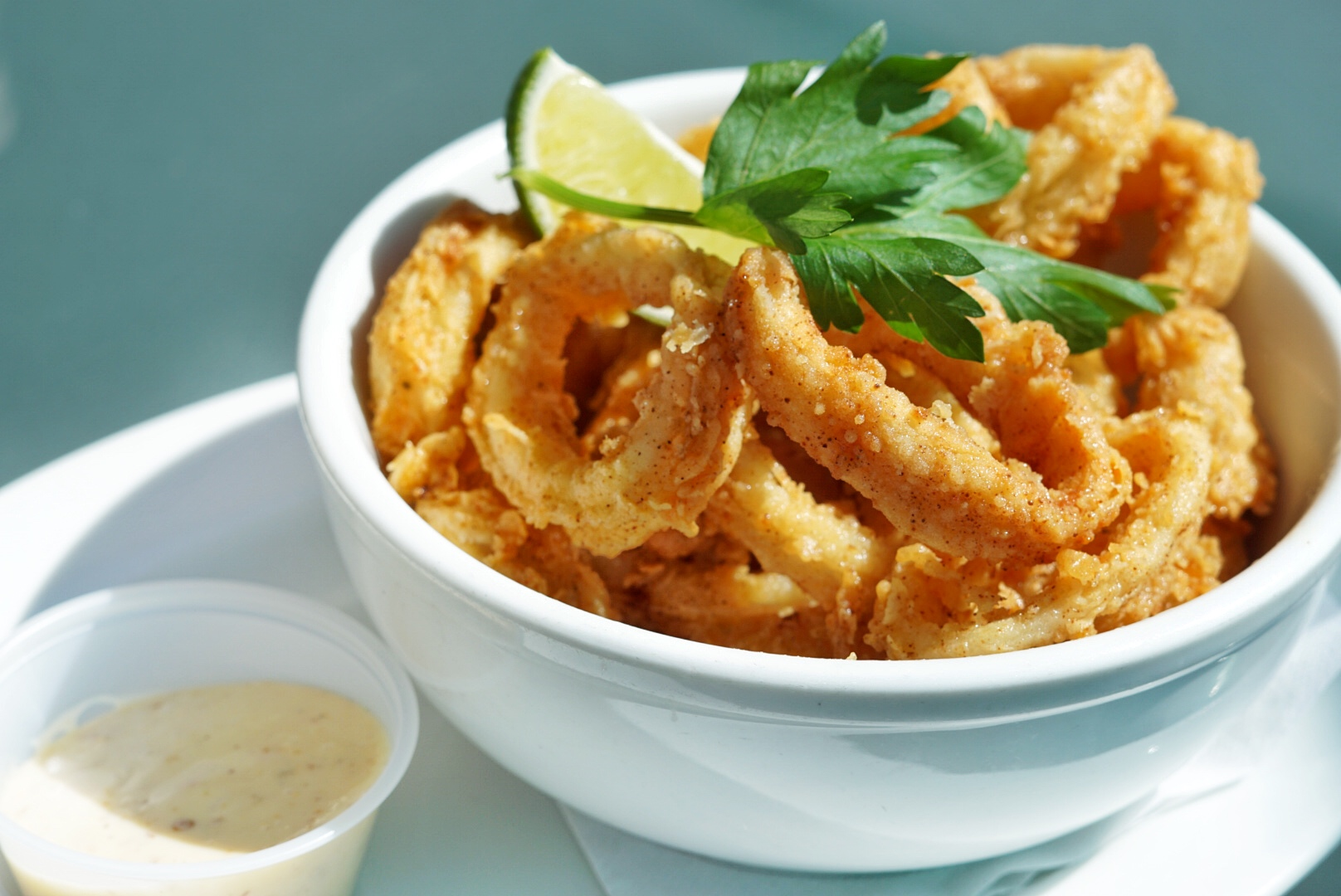 Lightly battered, crispy calamari served with a jerk mayo