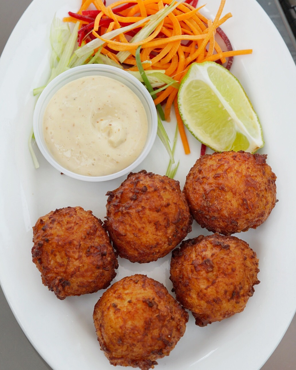 Fluffy Conch Fritters with jerk mayo