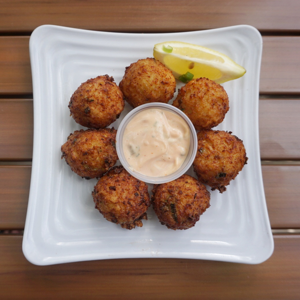 Fluffy Conch Fritters with a tangy (and mildly spicy) scotch bonnet remoulade.