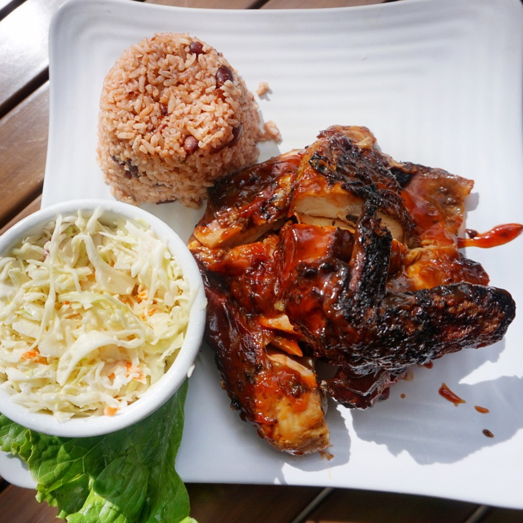 The 1/2 BBJerk Chicken is a saucier version of your traditional jerk as they combine BBQ and Jerk spices. I found the 1/2 chicken to be a lot for one (especially after adding in sides), so instead I'd recommend ordering a 1/4 chicken and add on your choice of 1-2 sides. Here I opted for their crisp coleslaw and rice & beans.