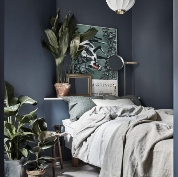 I love the use of plants and shelving here. And matches the current color palate. From gravityhomeblog.com