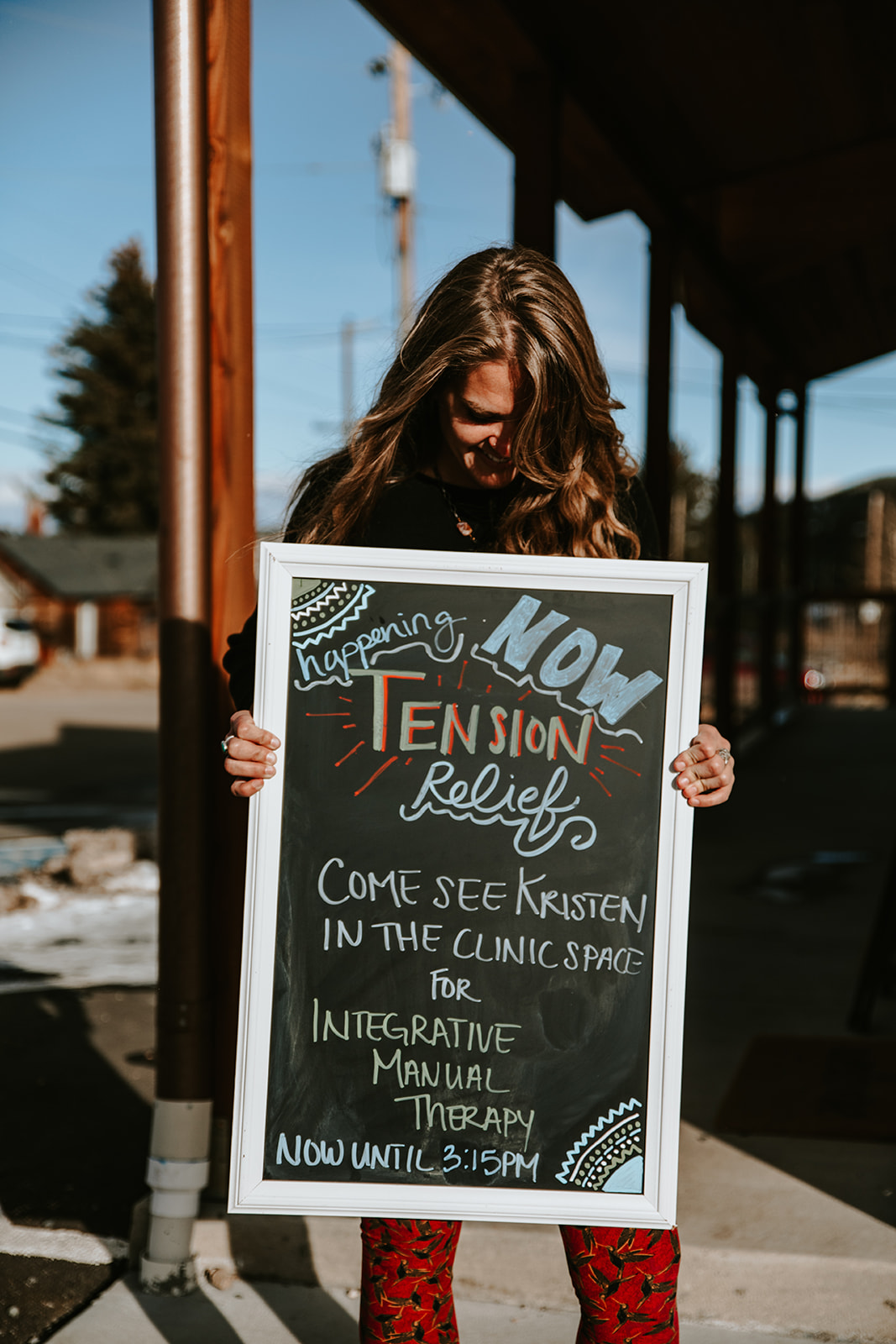 Kristen with tension relief sign in Nederland Colorado