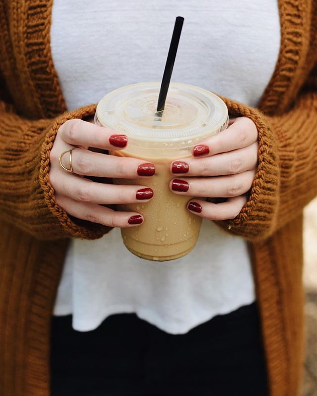 "Sweating in cozy sweaters while sipping on iced lattes is basically my entire Texas ""fall"" aesthetic. 😅 Anyone care to send some real crisp weather my way? 🍂🙏🏻 ✖️ Testers have gotten started on this pattern, and I am so excited! Can't wait to share more with y'all but for now, rest assured – there's some serious cozy coming your way. 😌 ✖️ Yarn: @koigu1 Chelsea in C5315 Pattern: Camper Cardigan, coming soon! ✖️ #ourmakerlife #knittersofig #knittersofinstagram #thatsdarling #stitchandhustle #creativityfound #thatsdarling #knitweardesigner #humansthatyarn #calledtocreate #campercardigan"