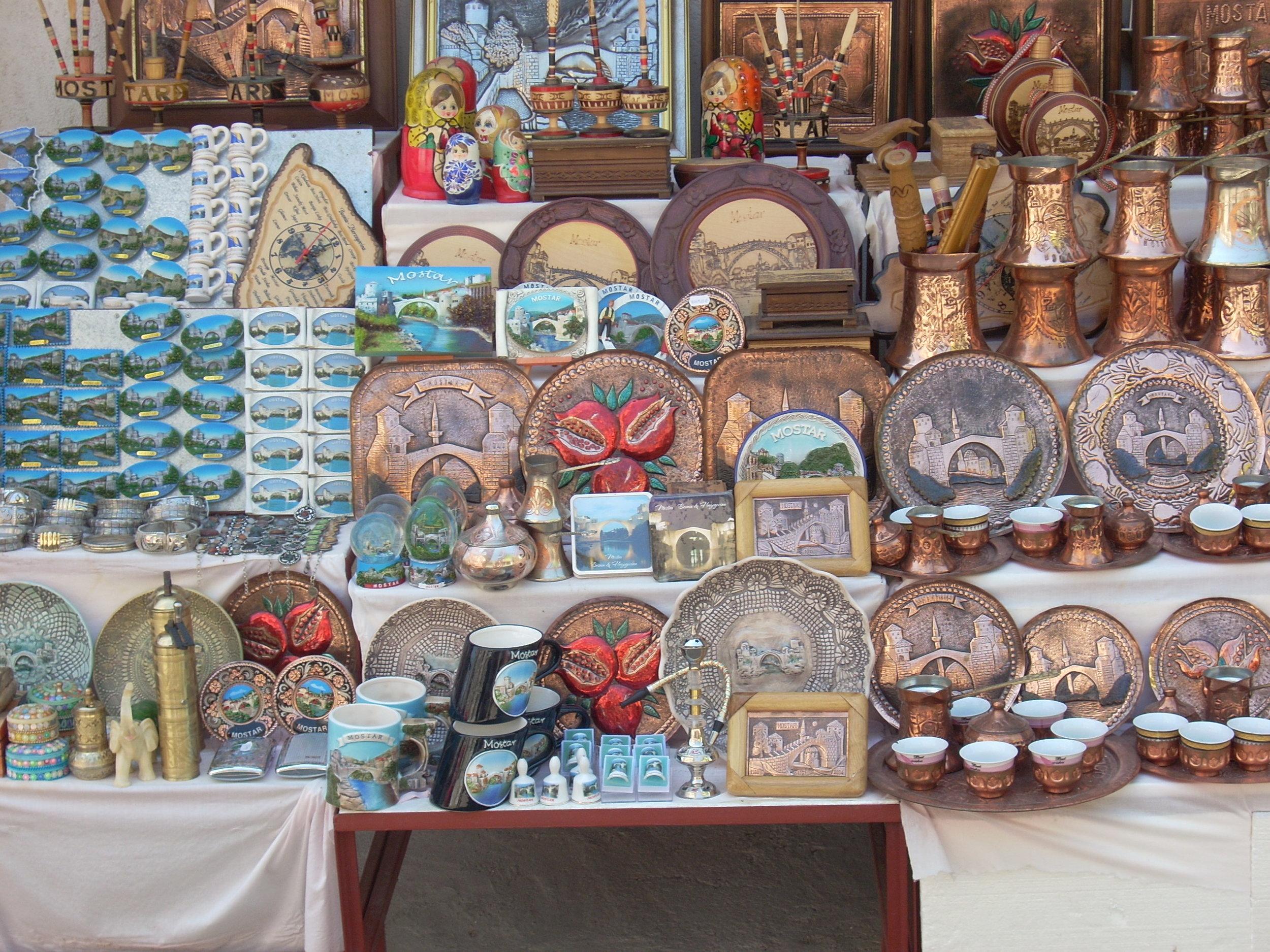 Džezve, fildžani, and handgrinder in Mostar market stall, 2009. A. Croegaert