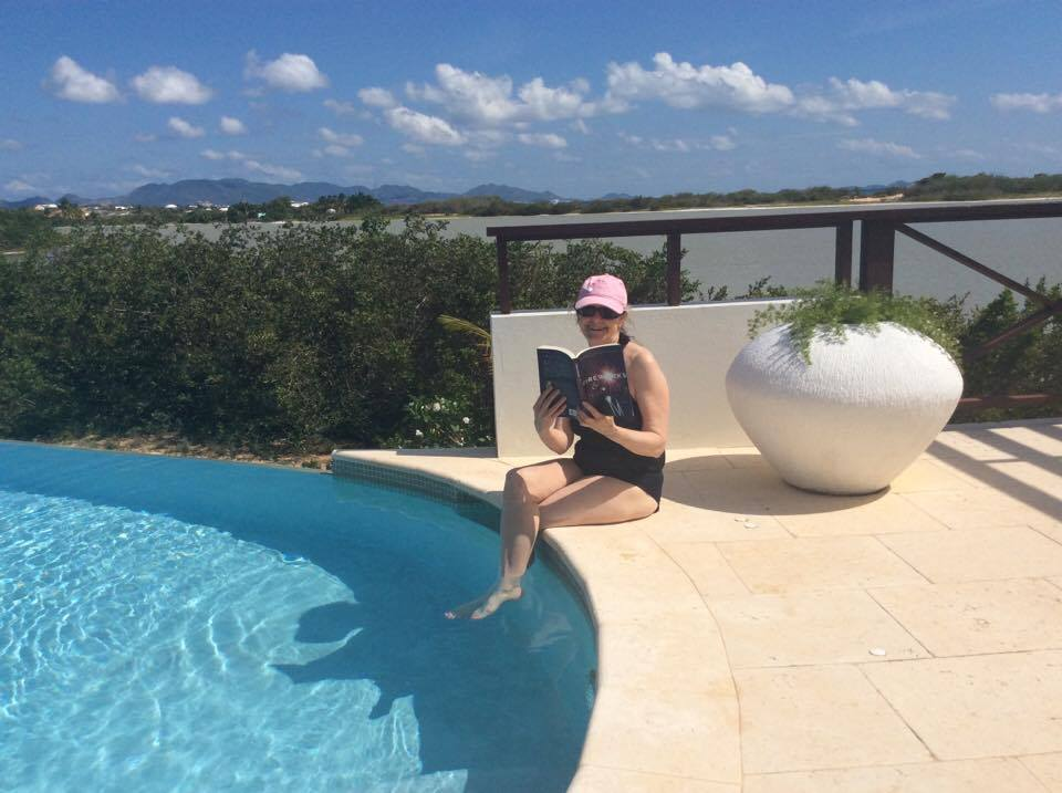 From ANGUILLA with a toast to deep azure and turning pages, Pam Phillips' style.