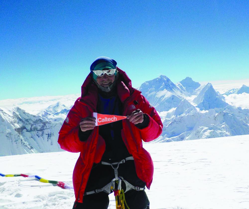 Kai Zinn shows his Caltech pride atop Tibet's Cho Oyu.