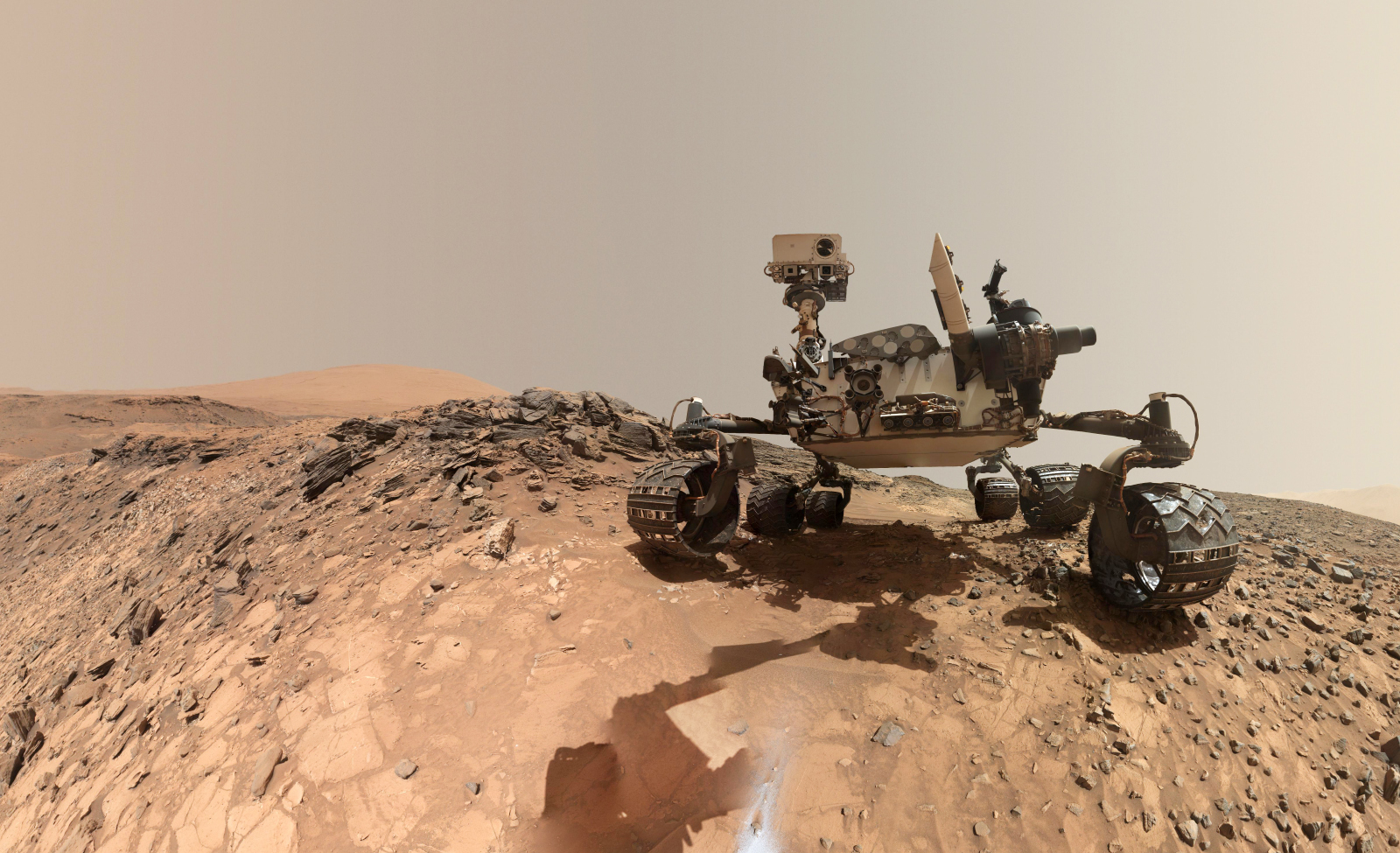 """This self-portrait of NASA's Curiosity Mars rover (created by stitching two images together and removing the rover's arm) shows the vehicle at the site from which it reached down to drill into a rock target called """"Buckskin"""" on lower Mount Sharp."""