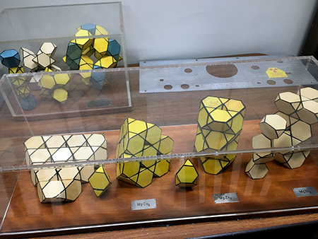 Polyhedron models of various intermetallic compounds (MgCu2, MgZn2, and MgNi2 in front). A common motif is the Friauf polyhedron represented by a truncated tetrahedron with four triangular faces and four hexagonal faces. Despite the simple formulas, some of these compounds (e.g., NaCd2) have extremely complicated crystal structures, which are still being studied today.