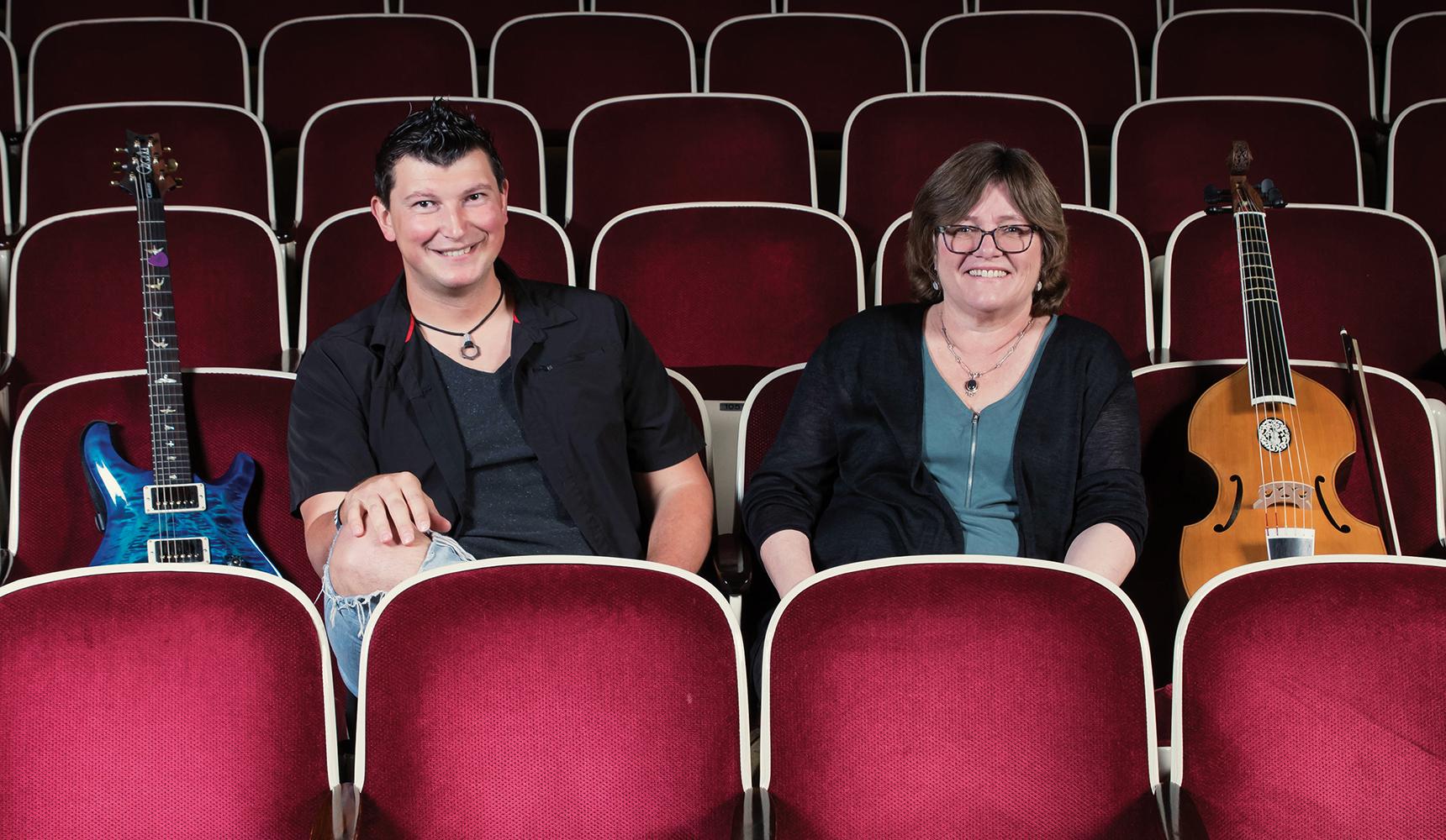 Konstantin Batygin and Lucy Jones share notes in Beckman Auditorium.