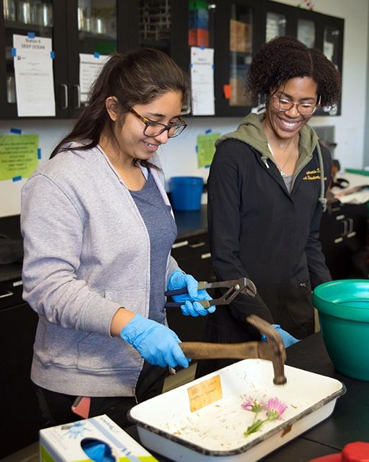 Graduate student Stephanie Threatt (right) shows Blair High School students an experiment involving liquid nitrogen during a recent STEMonstration.