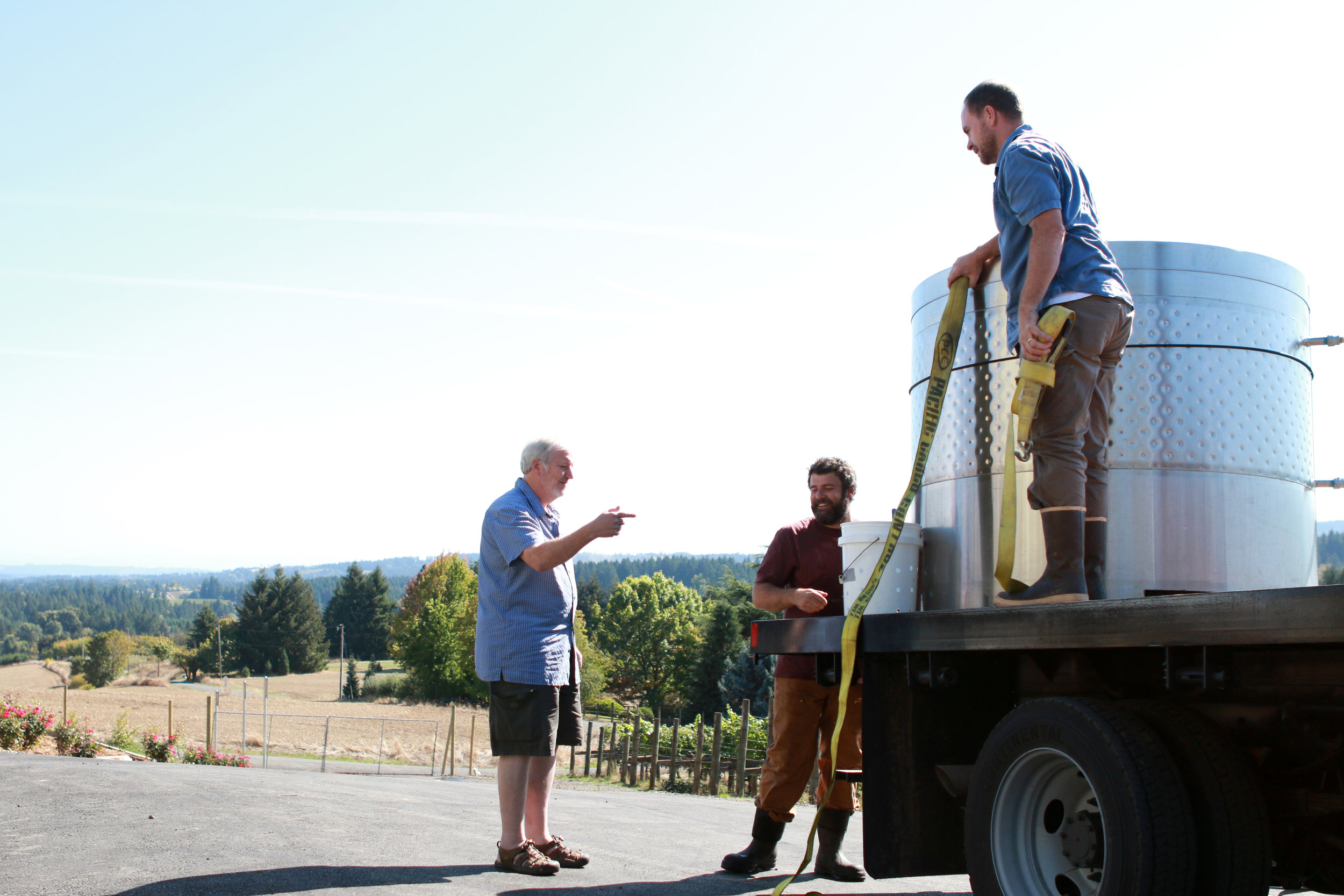 Steve Hendricks and Andrew Kirkland of Ruby Vineyard & Winery receiving fermentation tanks from Eric Hamacher during Harvest 2016. Eric has been the winemaking consultant for Ruby since 2015.
