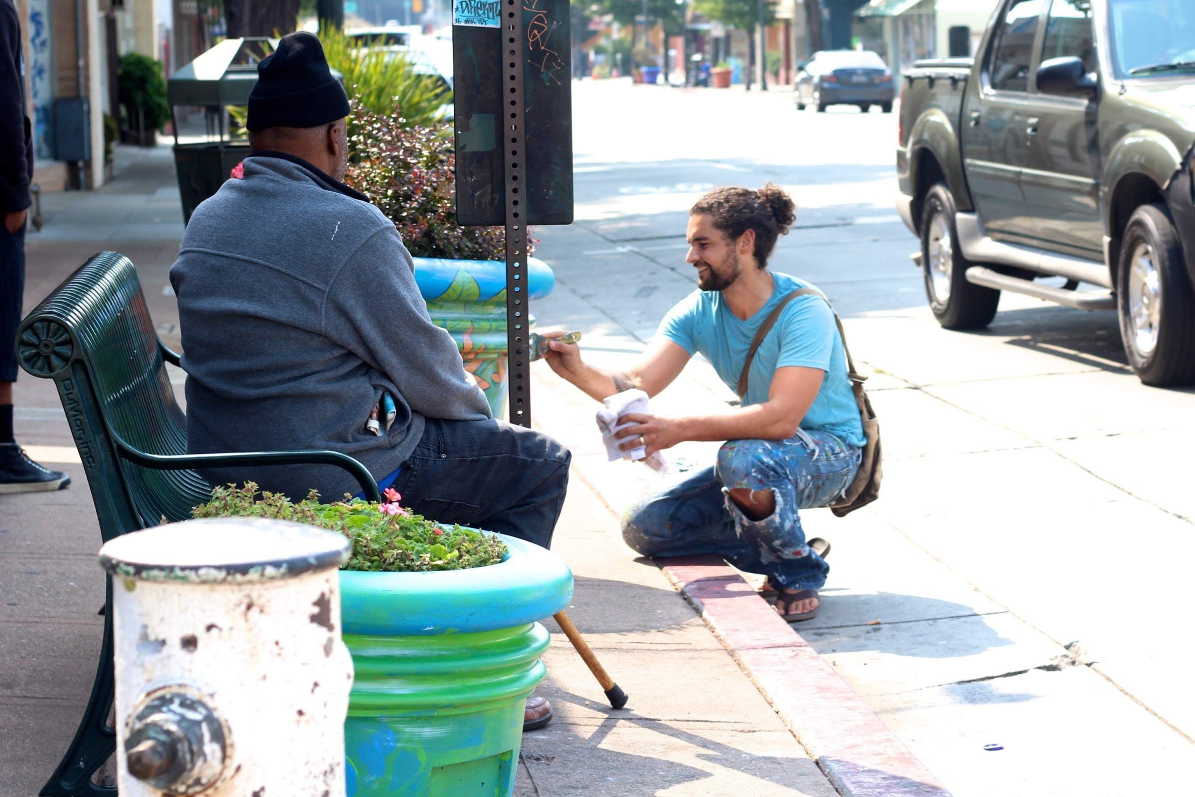 Jack painting a planter on MacArthur at 39th Ave in front of Cafe Santana.