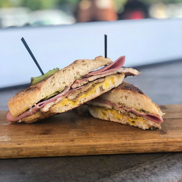 Our head chef prepared somethin' good for you all.  The Cubano sandwich with your choice of side- pork loin, ham, Swiss cheese, yellow mustard, garlic aioli, and pickles. Keep an eye out for our Chef's Special and make sure to ask your server what we have going on! *This is a while supplies last offer*