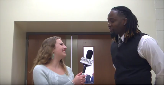 Stephanie Harte interviewing the Director of Gospel at Marquette for the choir's performance at the Democratic Debate in February 2016.