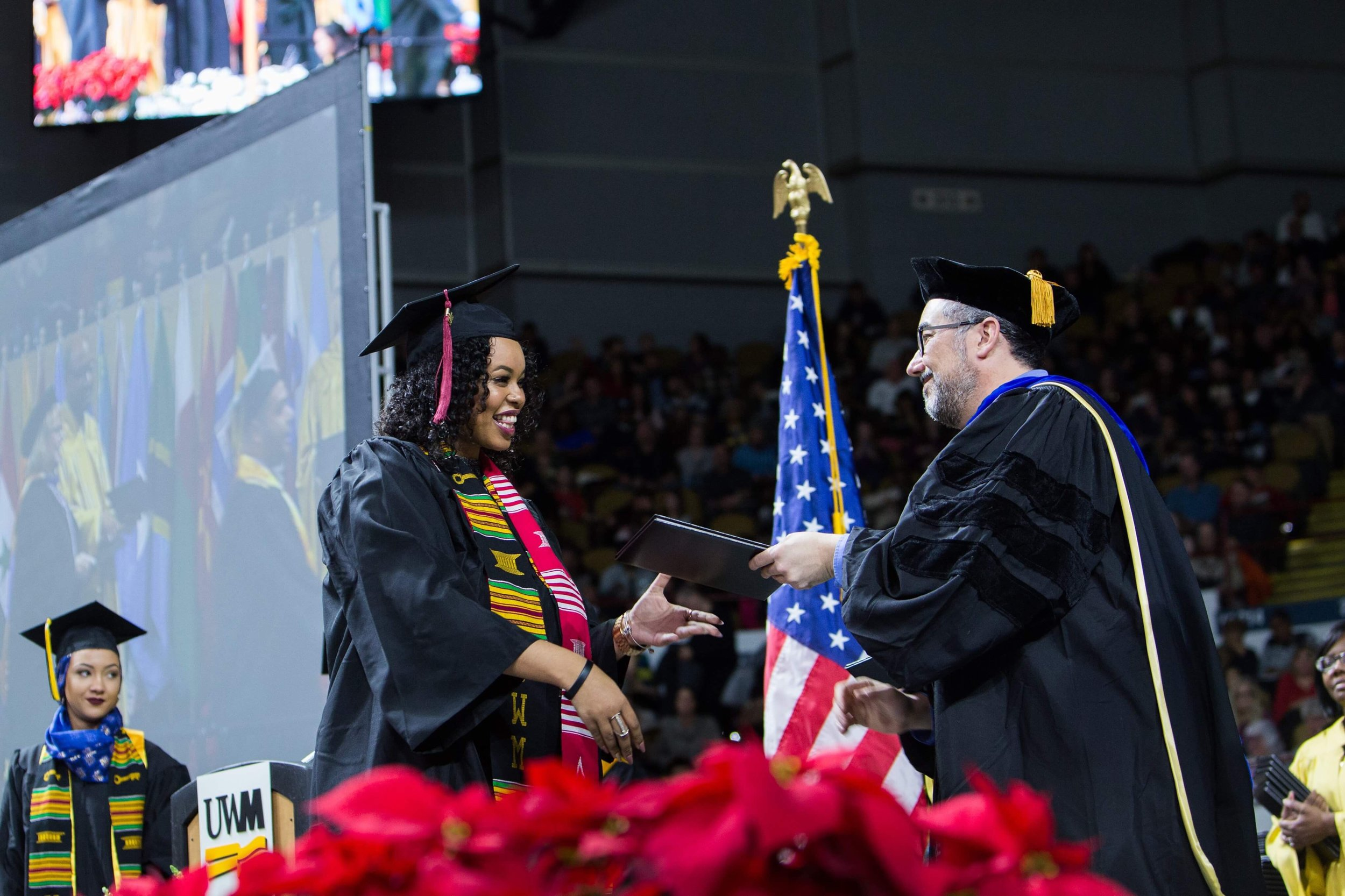 Miela Fetaw accepting her degree from the University of Wisconsin-Milwaukee. (Picture by Elora Hennessey)