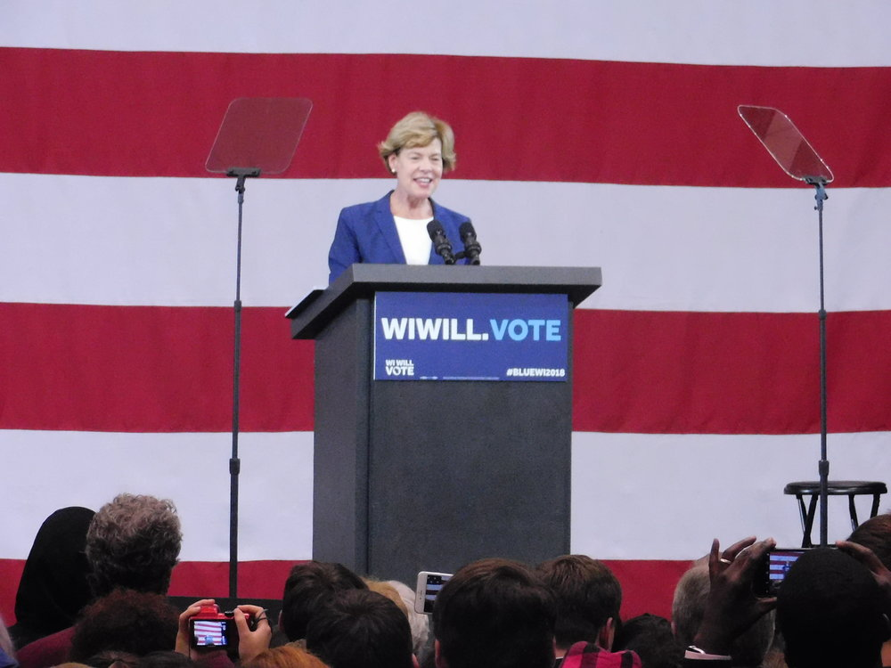 Tammy Baldwin shared her childhood story about struggling to get healthcare with the crowd. (Picture by Nyesha Stone)