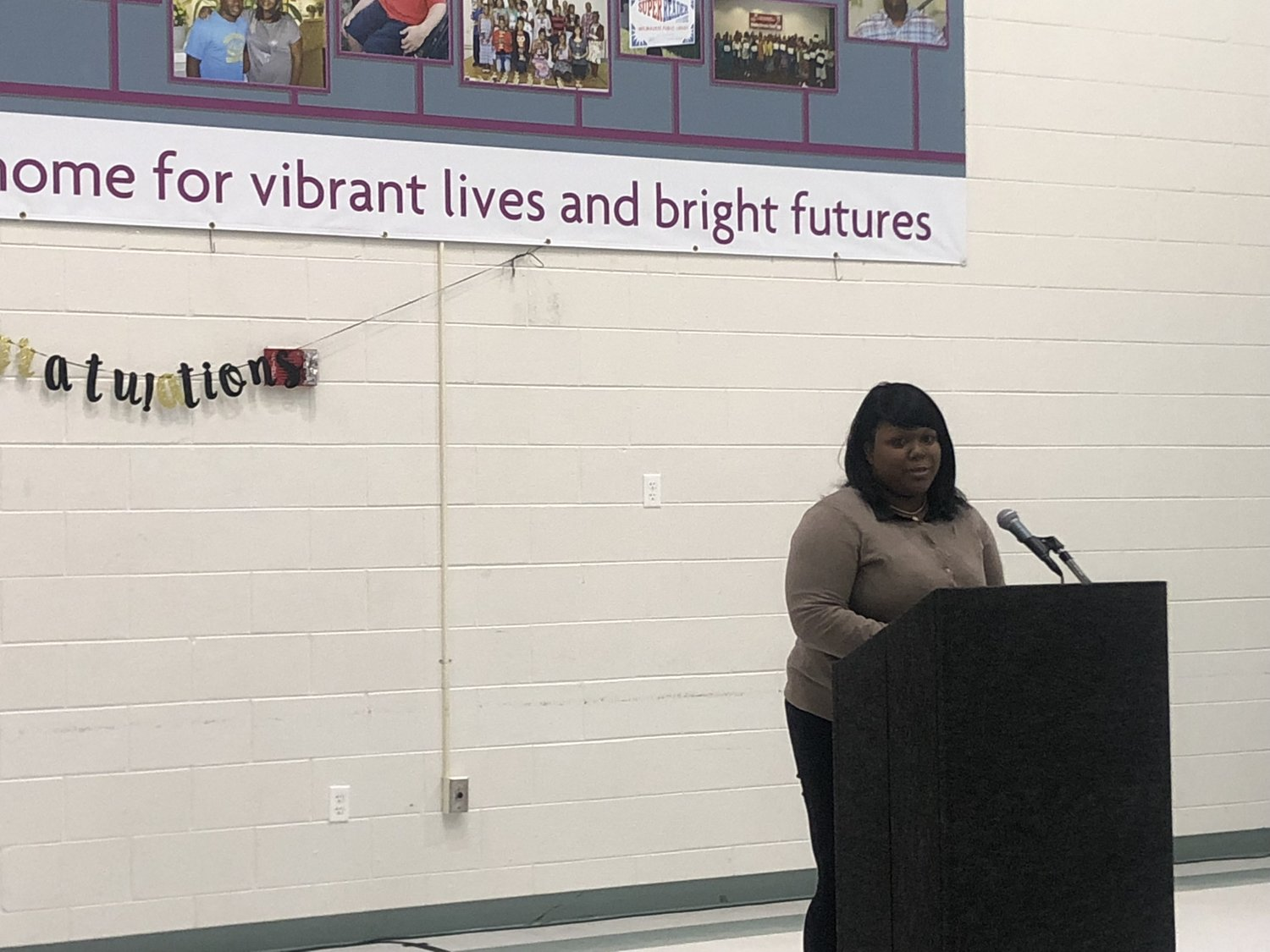 2016 Make Your Money Talk graduate Jasmine Rolland shares her story with the audience. (Picture by Nyesha Stone)