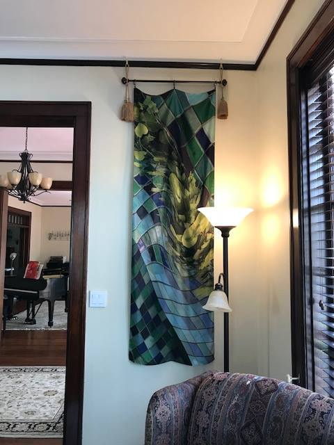 Berlin Wall I  silk twill scarf hanging in a private collection. It can easily be slipped off the rod and worn as a scarf or even a belt.