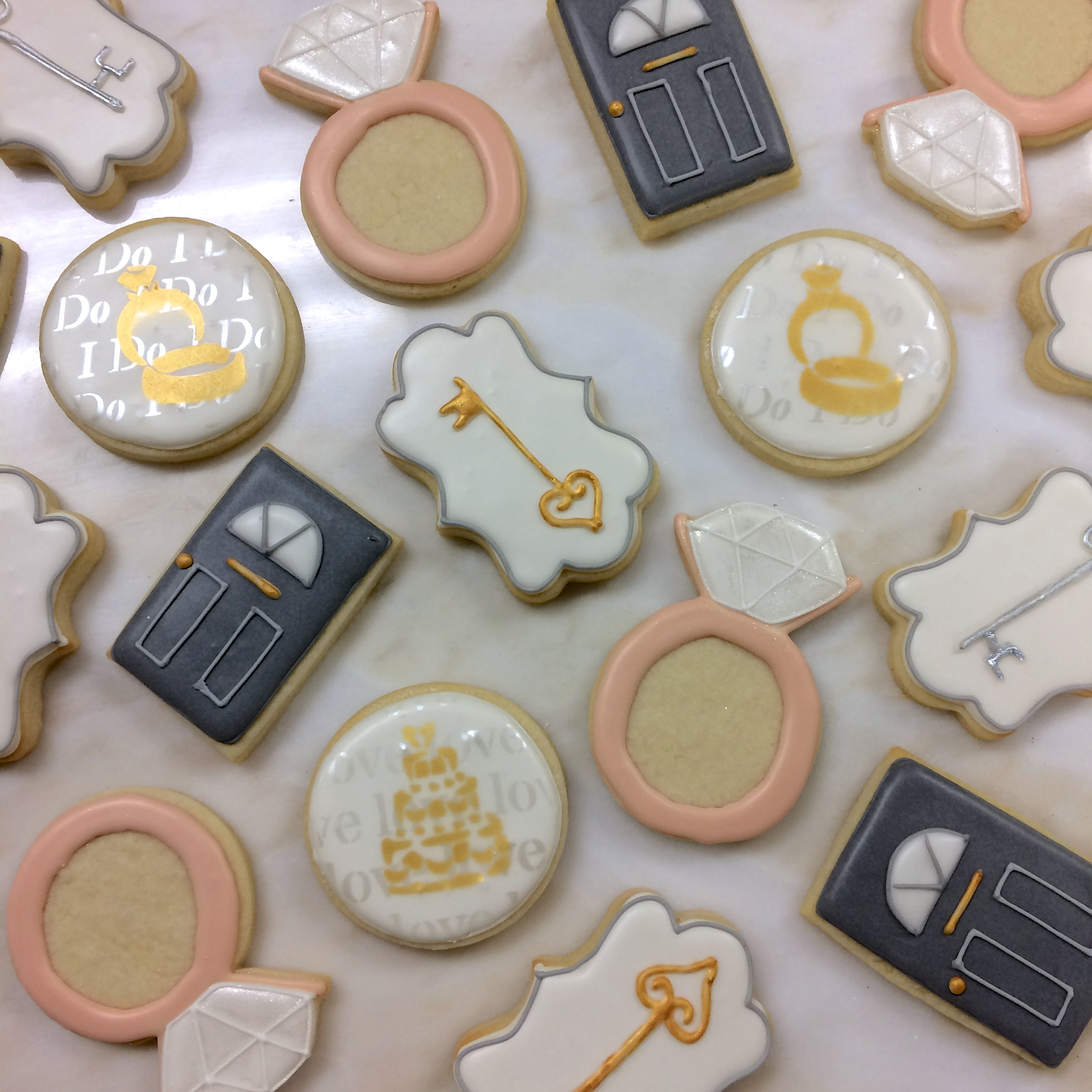 Gold and blush housewarming cookies by Seed Confections