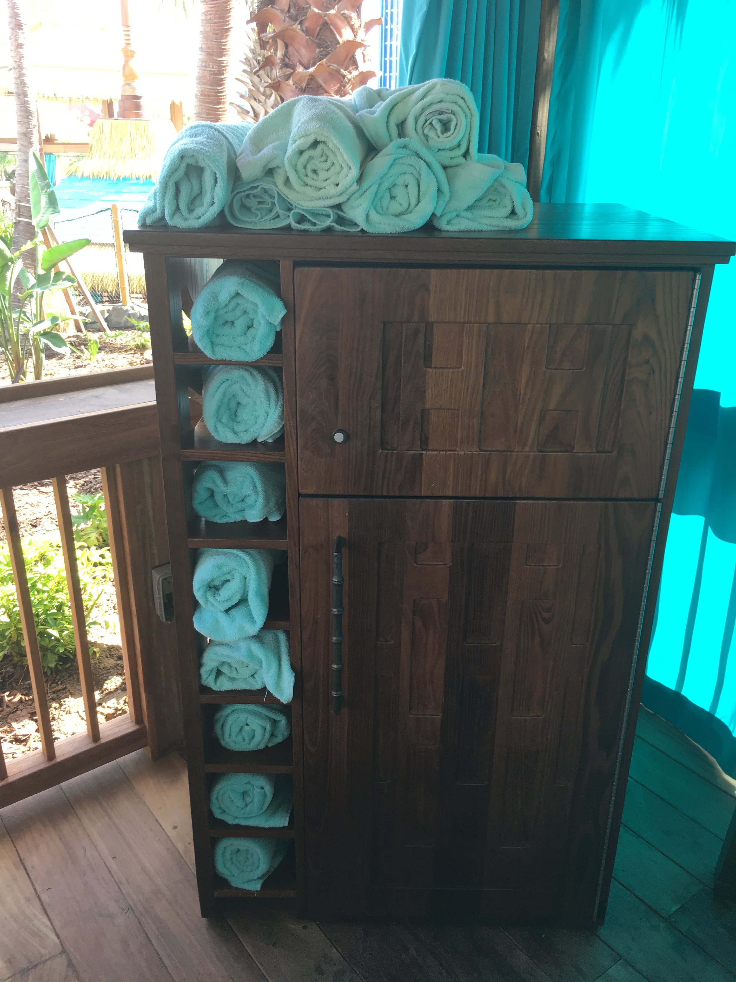 This cabinet holds the towels, mini fridge and locker