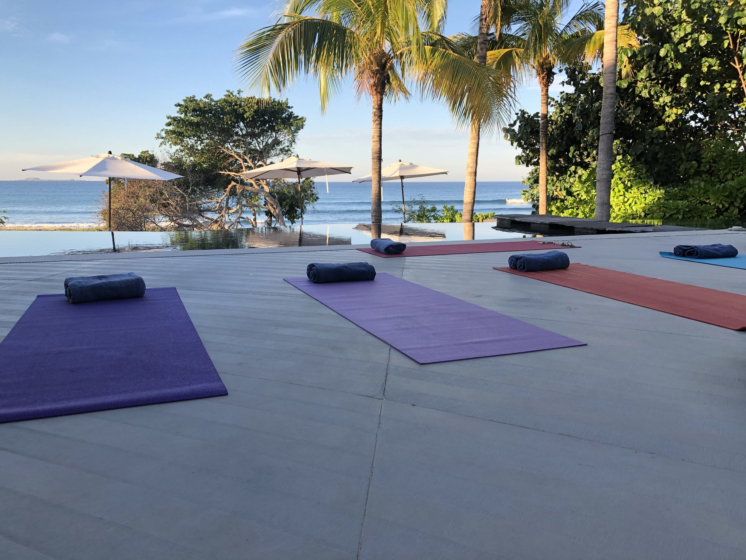 Private yoga lesson by the pool