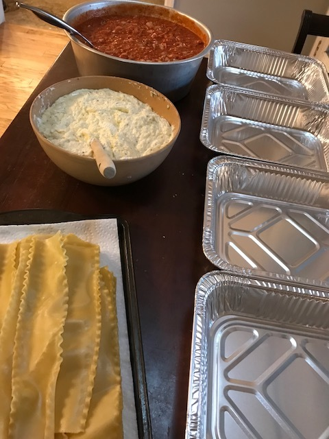 This was my assembly line for this batch of lasagnas...I actually had to add one more pan to make 5 to store away in the freezer!