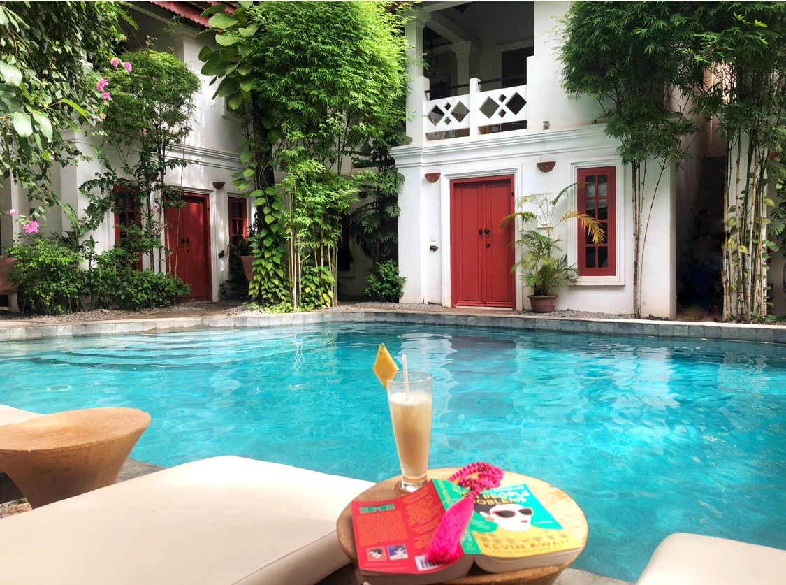 rambutan_hotel_pool_book.jpg