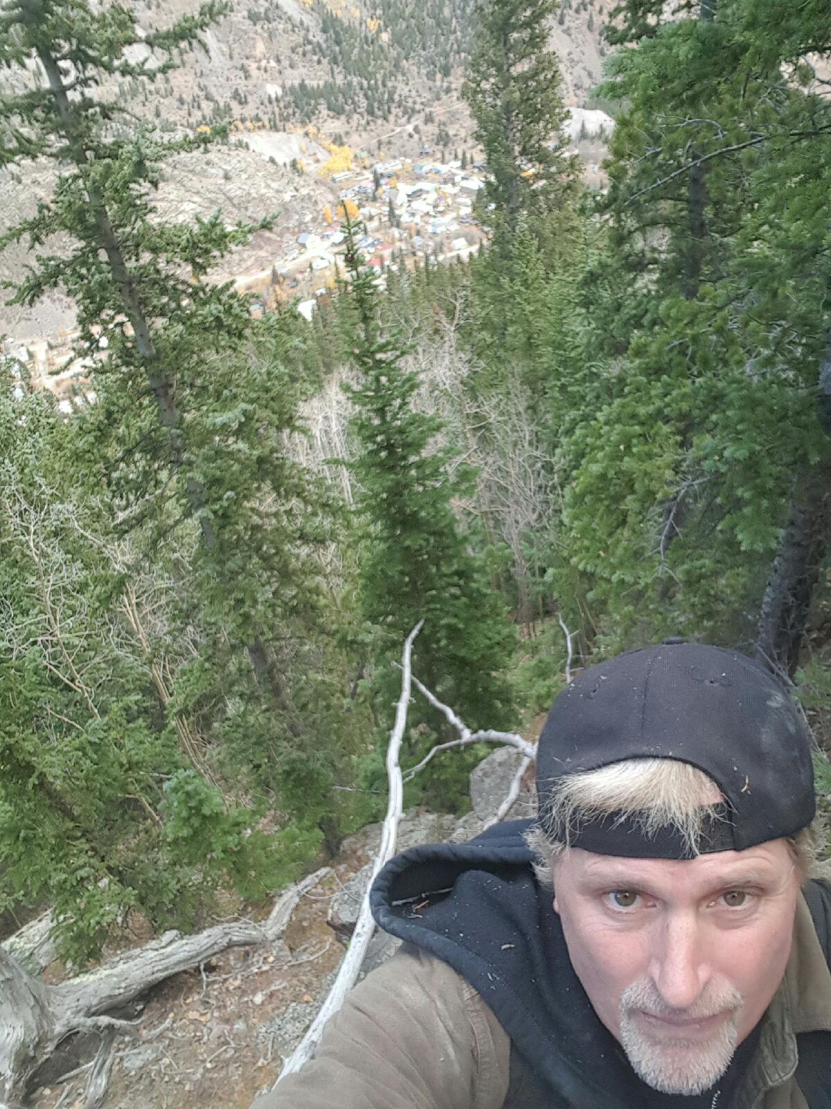 Keith's son, Kai-Allen Reinhard, searches Pendleton Mountain