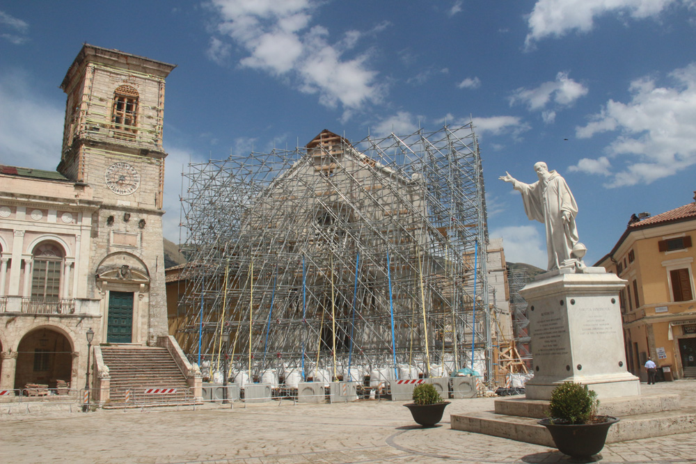 The main square with basilica and statue of Saint Benedict.